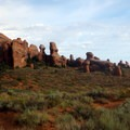Rock formations showcase the geology of Arches National Park.- Landscape Arch