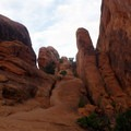 Sandstone that you have to climb up.- Double O Arch Trail