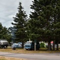 The camping area is in an open meadow.- Chéticamp Campground