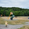 A playground in the meadow camping area.- Chéticamp Campground