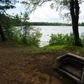 A typical campsite view at Fish Creek Pond State Park.- Fish Creek Pond State Park