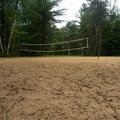 The volleyball court.- Fish Creek Pond State Park
