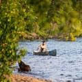 A canoe on the lake.- Lake Clear Beach