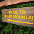 The trail to Debar Mountain starts in the campground.- Meacham Lake Campground
