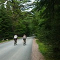 Bicyclists enjoy the campground loop road.- Meacham Lake Campground