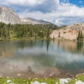 Shallower section of Lake Marie with nice colors in the water.- Medicine Bow Peak Loop