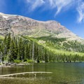 Rising Wolf Mountain and the north shore of Two Medicine Lake.- Two Medicine Lake Boat Tour