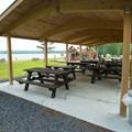 Picnic shelters near the beach.- Meacham Lake State Park