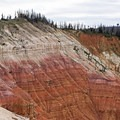 Look at the many layers of color. Red and yellow derives from iron oxide, and the purple derives from manganese oxide.- Spectra Point Trail
