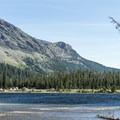 View of the campground from across Pray Lake.- Two Medicine Campground