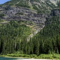 The far end of Avalanche Lake is a great place to relax with more solitude.- Avalanche Lake Hike