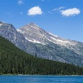 McPartland Mountain stands about 6 miles away.- Avalanche Lake Hike