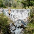 A dam and waterfall at Natural Bridge State Park.- Natural Bridge State Park