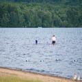 Swimmers enjoying the shallow water.- Meacham Lake Beach