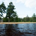 Looking back at the beach from the swimming area.- Meacham Lake Beach