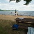 Picnic tables near the beach.- Meacham Lake Beach