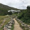 The Madison Spring Hut appears above the treeline.- Presidential Traverse