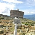 A trail sign reminds you of the long road ahead to Mount Washington.- Presidential Traverse