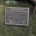 A plaque denotes the historic significance of the Crawford Path.- Presidential Traverse
