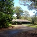 One of the picnic shelters adjacent to the cabins.- Kalōpā State Park and Recreation Area Campground