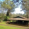 The larger outdoor day use picnic shelter and bathrooms.- Kalōpā State Park and Recreation Area Campground