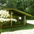 The pavilion and bathrooms within the tent area.- Kalōpā State Park and Recreation Area Campground