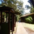 The cabins are located next to maps and information about the area.- Kalōpā State Park and Recreation Area Campground