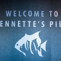 The welcome sign and North Carolina Aquariums logo inside the building.- Jeanette's Pier and Beach Access