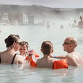 A family enjoying the warm water.- Blue Lagoon