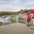A viewing platform overlooking the falls.- Hraunfossar and Barnafoss