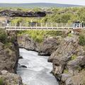 A walk bridge over the Hvitá River.- Hraunfossar and Barnafoss