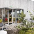 An outdoor seating area.- Laugarvatn Fontana