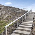 Stairs rise higher around the crater.- Grábrókargígar Natural Monument