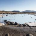Jarðböðin is set in a vast and colorful landscape.- Mývatn Nature Baths