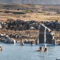 Stand under the massage waterfalls.- Mývatn Nature Baths