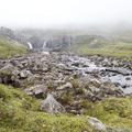 Serene waterfalls emerging from the fog.- Neðri-Stafur and Seyðisfjörður