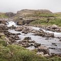 The cascading Fjardara River.- Neðri-Stafur and Seyðisfjörður