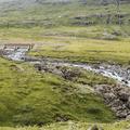 The path stays close to the riverbank.- Neðri-Stafur and Seyðisfjörður