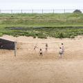 A volleyball court on the beach.- Nauthólsvík Geothermal Beach