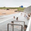 Guests enjoying the hot tub.- Nauthólsvík Geothermal Beach