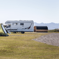 Space for RVs and campers.- Djúpivogur Campground