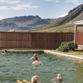 A beautiful setting beneath high mountains.- Lýsuhólslaug Geothermal Pool