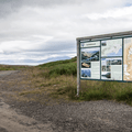 Parking area and information sign.- Súlur