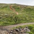 A series of trails begin up a small hill.- Súlur