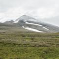 Súlur appearing through the clouds.- Súlur