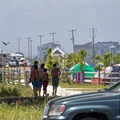 Campers walking back from the beach.- Delaware Seashore State Park Campground