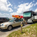 A camper and their set up.- Delaware Seashore State Park Campground