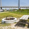 A communal fire pit.- Delaware Seashore State Park Campground