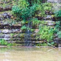 Spring breaks through the rock wall.- Waterloo Falls