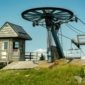 The chairlift marks the unofficial top of Mount Ellen. The actual summit is wooded with no views.- Mount Ellen via the Long Trail